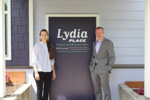 Derek Thornton and Emily O'Connor stand in front of the Lydia Place office at the Gladstone House property. Photo credit: Kenneth Clarkson.